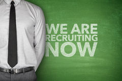 We are recruiting now on blackboard. With businessman Royalty Free Stock Photos
