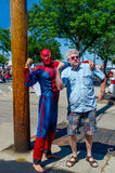 Recruiting super heros. Spiderman recruits a super hero off the streets in this fun event in down town stevensville michigan stock image