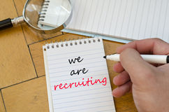 We are recruiting text concept on notebook Stock Photos