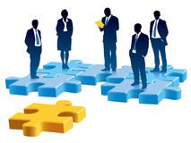 Recruitment. People are standing on colored pieces of jigsaw puzzle Royalty Free Stock Photo