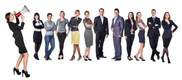 Recruitment agency. Business women with megaphone standing in front of other busines people Royalty Free Stock Photography