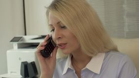 Recruitment agency manager calling customers, inviting for employment interview. Stock footage stock video