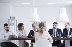 Recruitment meeting in the company. Businessman asking a women why she wants to work in the company during a recruitment meeting Royalty Free Stock Photography