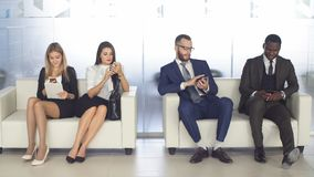 Recruitment to the company. Young applicants are awaiting interview. a group of young people bored waiting for job. Interview Royalty Free Stock Photography