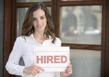 Recruitment : woman holding a hired sign Stock Image