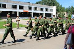 Recruits marching to the checkpoint for a meeting with relatives. Royalty Free Stock Image