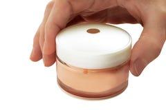 Rectángulo con una crema para el cuidado de piel Fotos de archivo