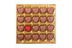 Rectángulo cuadrado con los bombons del chocolate de la dimensión de una variable del corazón Fotografía de archivo libre de regalías