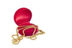 Rectángulo de joyería y collar de oro Foto de archivo libre de regalías