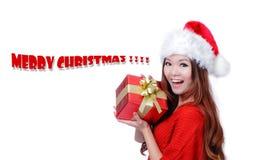 Rectángulo de regalo de la explotación agrícola de la sonrisa de la muchacha de la Navidad Imagen de archivo