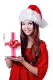 Rectángulo de regalo de la explotación agrícola de la sonrisa de la muchacha de la Navidad Fotos de archivo