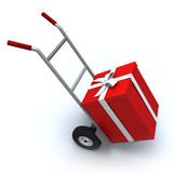 Rectángulo de regalo en carro del empuje Imagen de archivo libre de regalías