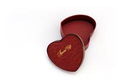 Rectángulo de regalo en forma de corazón rojo Imagen de archivo libre de regalías