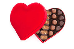 Rectángulo de regalo que come chocolates Fotos de archivo