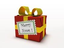 Rectángulo de regalo rojo aislado en el fondo blanco con feliz Navidad de la escritura de la etiqueta Fotografía de archivo libre de regalías