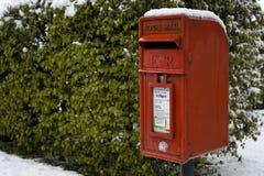 Rectángulo rojo del poste en la nieve Fotos de archivo