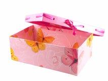 Rectángulo y cinta de regalo rosado aislados en blanco Imagen de archivo libre de regalías