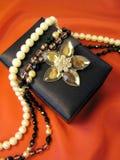 Rectángulo y joyas de regalo Imagenes de archivo