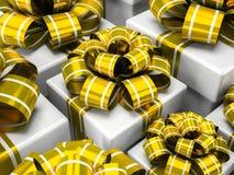 Rectángulos de regalo con los arqueamientos del oro Imágenes de archivo libres de regalías