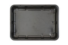 Rectangle black plastic food tray. Isolated white background Royalty Free Stock Images