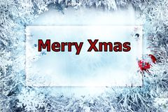 Rectangle frame with Merry Xmas greeting. Framed by shiny snowflake glitter royalty free stock photo