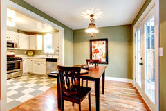 Rectangle olive tones dining room Stock Photos