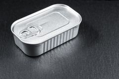 Rectangular aluminum packaging canned without a label on a stone background royalty free stock image