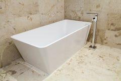 Rectangular bathtub. Modern rectangular bathtub in new bathroom Royalty Free Stock Photo