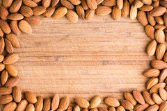 Rectangular border or frame of fresh almonds Royalty Free Stock Photography