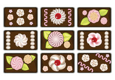 Rectangular cakes. In chocolate icing decorated with butter cream Stock Photos