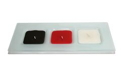 Rectangular candle holder. With three square candles Royalty Free Stock Photos