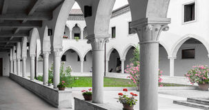 Rectangular cloister with Gothic arches and  columns. Royalty Free Stock Photos
