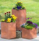 Rectangular flower pot in a park Stock Photos