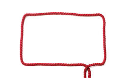 Rectangular frame of red cord with ends Stock Image