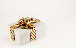 Rectangular gift box  with golden ribbon and bow. Isolated on white Stock Photo