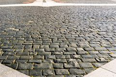 Fragment of the square, paved with granite stone, in front of the Naval Cathedral in Kronstadt, Russia. Rectangular granite processed stones of various sizes stock photos