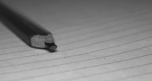 Rectangular Graphite pencil. A Rectangular graphite pencil on paper for taking notes Royalty Free Stock Photography