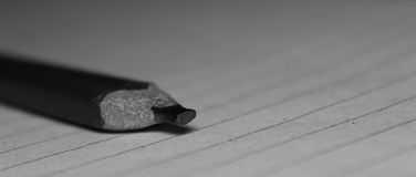 Rectangular Graphite pencil. A Rectangular graphite pencil on paper for taking notes Stock Image