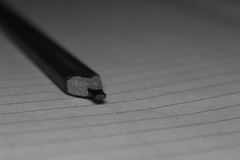 Rectangular Graphite pencil. A Rectangular graphite pencil on paper for taking notes Stock Photos
