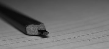 Rectangular Graphite pencil. A Rectangular graphite pencil on paper for taking notes Stock Photo