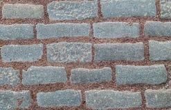 Rectangular gray stone granite and gravel stripes red part garden path background base design pattern stock photo
