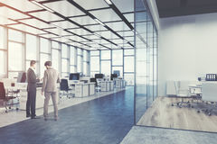Rectangular open space office, corner, people. Open space office interior with a concrete floor, a rectangular ceiling pattern and panoramic windows. Computers royalty free stock photography
