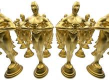 Rectangular pattern of golden statues Stock Photography