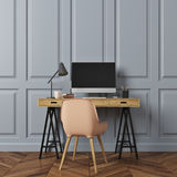 Rectangular pattern room, computer desk, beige. Empty room interior with gray rectangular pattern walls and a dark wooden floor. There is a wooden computer desk Stock Image