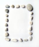 Rectangular pebbles frame. Frame made up of grey, bluish white pebbles neatly arranged in a rectangular shape.  Can be used in horizontal or vertical format Royalty Free Stock Images