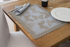 Rectangular Placemat with Embroidered Butterfly Design Laid on T Royalty Free Stock Photo