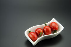 Rectangular plates in the small red tomatoes Stock Image