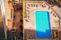 Rectangular Pool Near High Rise Building during Daytime Stock Images
