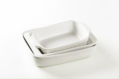 Rectangular porcelain dishes. Three rectangular white porcelain baking dishes Royalty Free Stock Photo