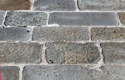 Rectangular rock tiles on a road pavement Royalty Free Stock Photo